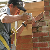 Chimney repair services being performed on deteriorating chimney in Buckhead GA near Piedmont Hospital